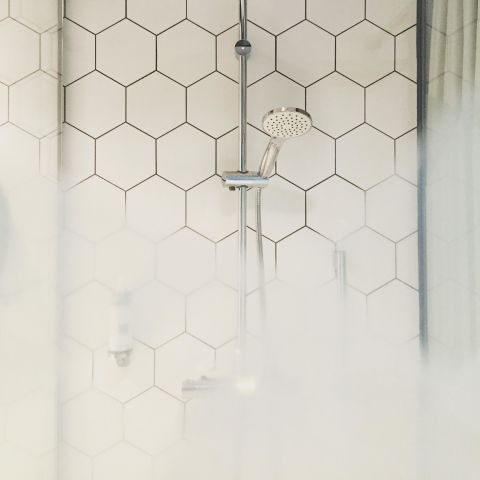 The easiest way to rid your shower tiles of grout is regular upkeep, which is why our cleaning expert Heloise says you should run a squeegee over tile after every use. By drying the walls, you'll prevent mildew stains.